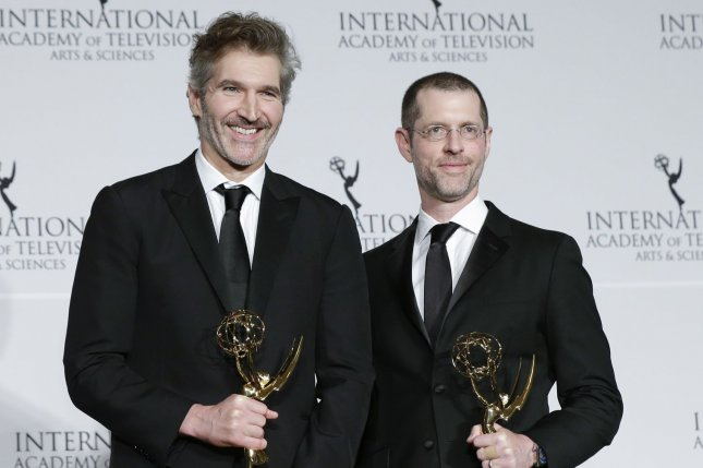 Game of Thrones creators David Benioff (L) and D.B. Weiss, pose with their awards at the 47th International Emmy Awards on November 25. The duo have announced their next project, which is coming to Netflix. File Photo by John Angelillo/UPI