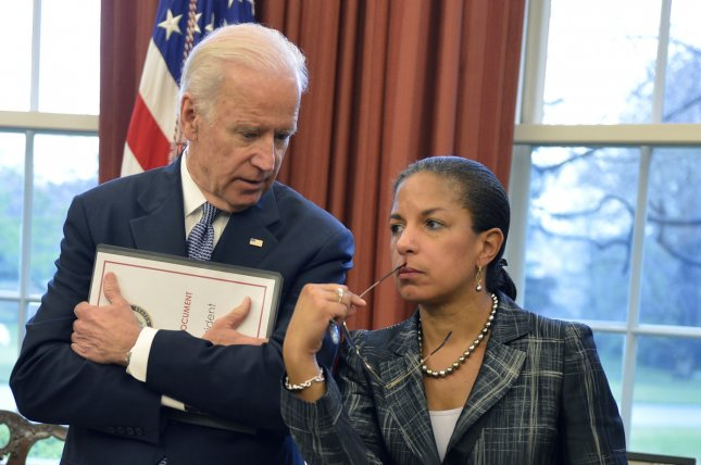 Then-Vice President Joe Biden (L) and national security adviser Susan Rice confer in the Oval Office in 2015. File Photo by Mike Theiler/UPI