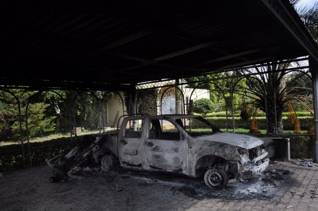 A burnt building is seen at the United States consulate, one day after armed men stormed the compound and killed the U.S. Ambassador Christopher Stevens and three others in Benghazi, Libya on September 12, 2012. The gunman were protesting a little known film by an American amateur filmmaker that angered Muslims as it was deemed insulting to the Prophet Mohammad. -- UPI/Tariq AL-hun