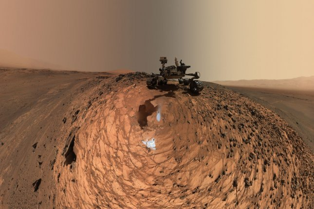 A selfie image captured using Curiosity's Mars Hand Lens Imager shows the rover ascending Mount Sharp in 2015. Photo by NASA/UPI