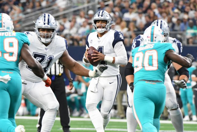 Dallas Cowboys quarterback Dak Prescott (4) threw two touchdown passes to wide receiver Amari Cooper in a win against the Miami Dolphins Sunday at AT&T Stadium in Arlington, Texas. Photo by Ian Halperin/UPI