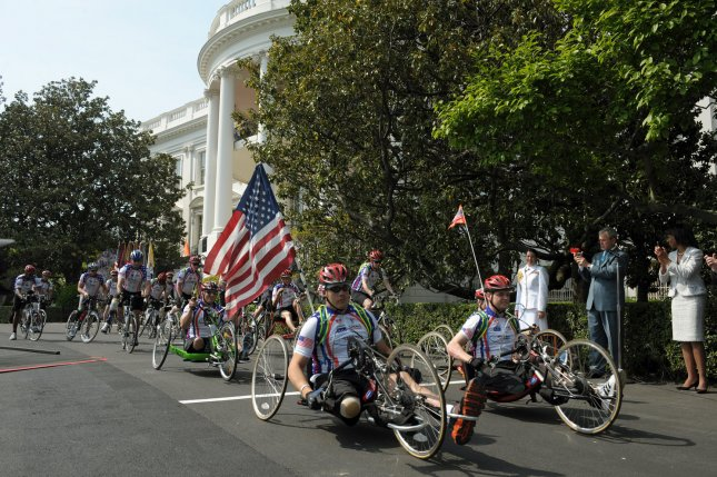 U.S. President George W. Bush helps kick off the Wounded Warrior Ride on the South Lawn of the White House in Washington on April 24, 2008. Dozens of veterans wounded in Iraq and Afghanistan are participating in the three day bicycle ride that will end in Annapolis, Maryland. (UPI Photo/Roger L. Wollenberg)
