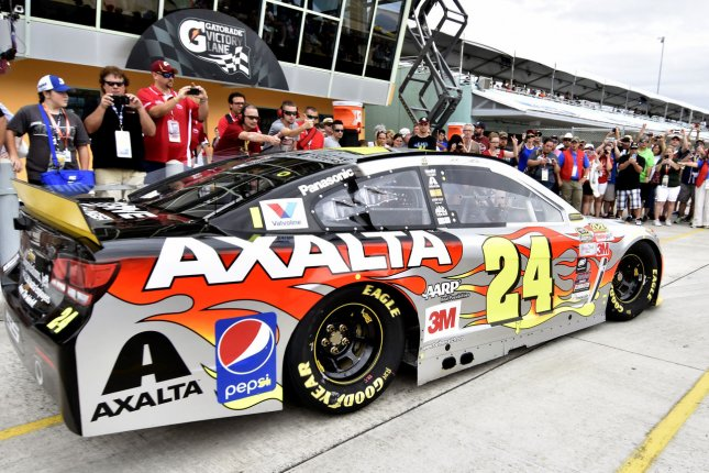 NASCAR Sprint Series racer Jeff Gordon (24) with race fans looking on, enters the track for a final practice round at Homestead-Miami Speedway in Homestead, Florida on November 21, 2015. Photo By Gary I Rothstein/UPI
