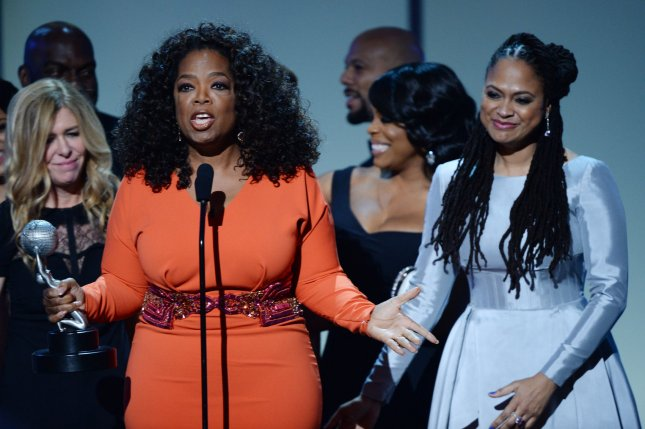 Oprah Winfrey (L) and director Ava DuVernay (R) and members of the cast of Selma accept the Outstanding Motion Picture award during the 46th NAACP Image Awards on February 6, 2015. Winfrey and DuVernay are set to colloborate again in a new film for Disney entitled A Wrinkle In Time. File Photo by Jim Ruymen/UPI