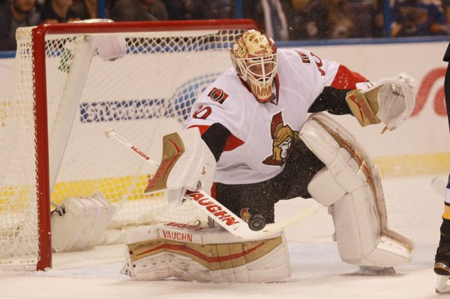 Ottawa Senators goaltender Andrew Hammond knocks the puck away in the second period against the St. Louis Blues at the Scottrade Center in St. Louis on January 4, 2016. Ottawa defeated St. Louis 3-2 in overtime. Photo by Bill Greenblatt/UPI