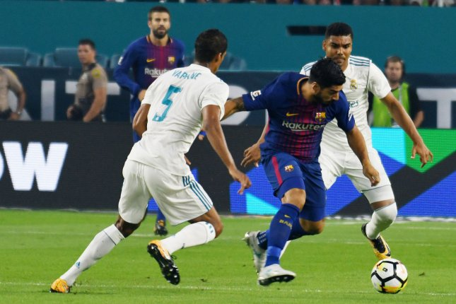 Barcelona's Suarez to miss World Cup qualifying with knee injury