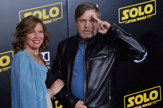 Mark Hamill (R) with his wife, Marilou York. Hamill appeared on Jimmy Kimmel Live to sell a pair of his pants. File Photo by Jim Ruymen/UPI