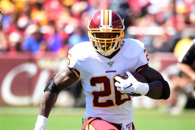 Washington Redskins running back Adrian Peterson ranks fifth in NFL history with 14,216 rushing yards. File Photo by Kevin Dietsch/UPI