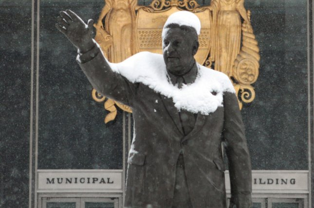 Snow covers part of a statue honoring former Philadelphia Mayor Frank Rizzo in front of the Municipal Building in Philadelphia, Pa., during a snowstorm on February 10, 2010. File Photo by John Anderson/UPI