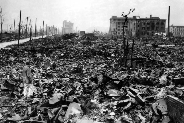 An unidentified newsman stands amid the rubble of Hiroshima in September 1945. On August 6, 1945, an atomic bomb was dropped on the city. UPI File Photo