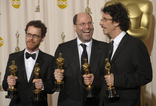 Producers Ethan Coen (L-R) Scott Rudin and Joel Coen pose with their Oscars after the film 'No Country for Old Men' won best motion picture of the year at the 80th Academy Awards in Hollywood on February 24, 2008. The Coen brothers also won for best director and adapted screenplay. (UPI Photo/Phil McCarten)