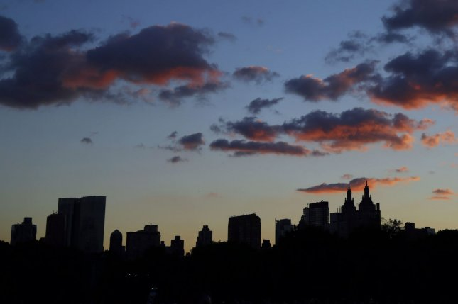 The sun sets in New York's Central Park. UPI/John Angelillo