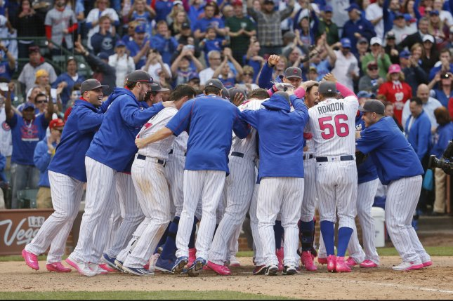 Chicago Cubs players celebrate a walk-off home run by shortstop Javier Baez (9) and a 4-3 win against the Washington Nationals in the thirteen inning at Wrigley Field in Chicago on May, 8, 2016. Photo by Kamil Krzaczynski/UPI