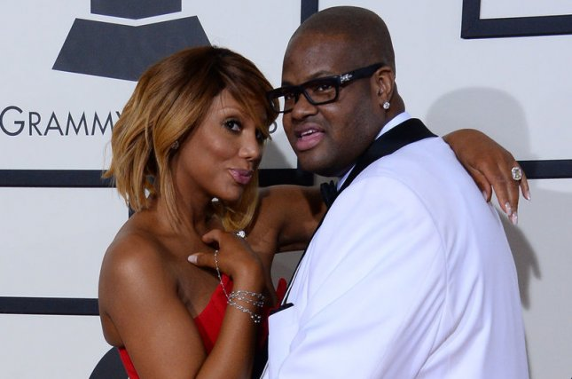Tamar Braxton (L) and Vince Herbert at the Grammy Awards on January 25, 2014. The couple married in 2008. File Photo by Jim Ruymen/UPI