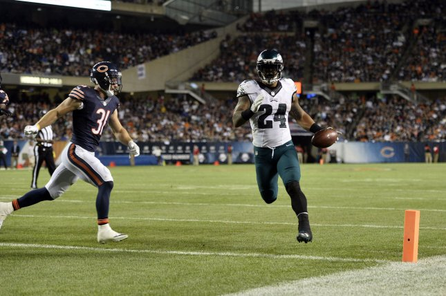 Philadelphia Eagles running back Ryan Mathews jogs into the end zone on a 1-yard touchdown run as Chicago Bears strong safety Chris Prosinski tries to catch up during the fourth quarter at Soldier Field in Chicago on September 19, 2016. The Eagles defeated the Bears 29-14. Photo by Brian Kersey/UPI