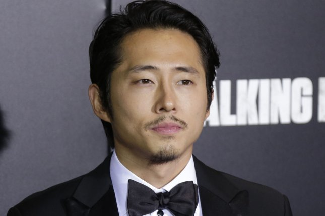 Steven Yeun arrives on the red carpet at AMC's The Walking Dead' Season 6 fan premiere event on October 9, 2015 in New York City. File Photo by John Angelillo/UPI