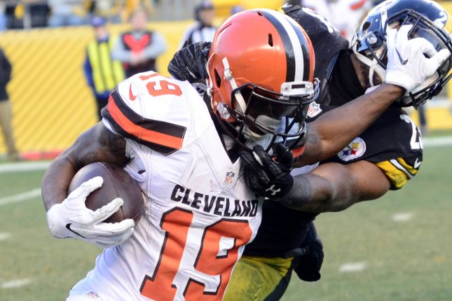 Pittsburgh Steelers free safety Mike Mitchell (23) receives a face mask penalty as he tackles Cleveland Browns wide receiver Corey Coleman (19) in overtime on January 1 at Heinz Field in Pittsburgh. Photo by Archie Carpenter/UPI
