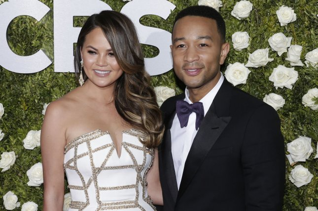Chrissy Teigen (L), pictured with John Legend, shared a cute picture of the singer with daughter Luna. File Photo by John Angelillo/UPI