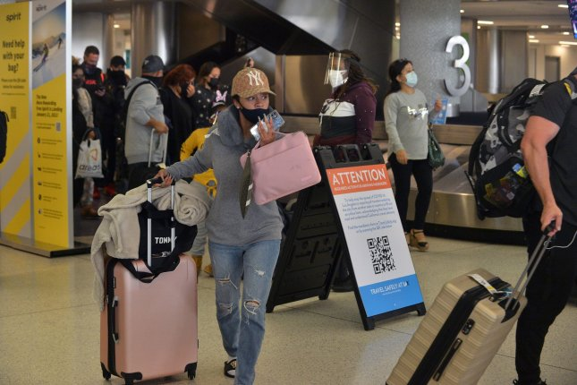 Travelers gather their luggage at Los Angeles International Airport on November 25. The TSA extended a mask requirement at airports through September 13. File Photo by Jim Ruymen/UPI