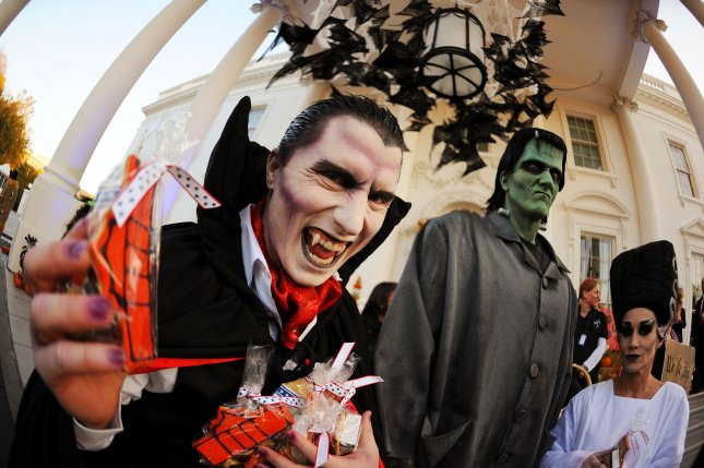 Monsters distribute candy for Halloween at the White House in Washington on October 31, 2010. UPI/Olivier Douliery/Pool