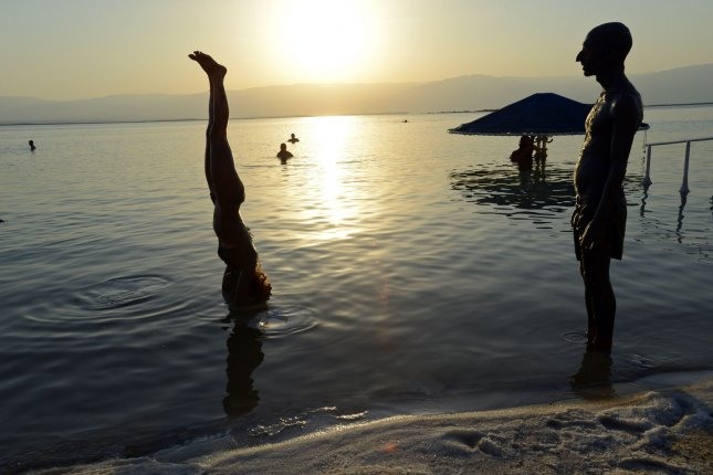A single session of yoga improved brain function. An Israeli does a yoga pose on a salt crust in the Dead Sea during an Israeli and international environmental and social protest float at dawn against the deterioration of the Dead Sea. UPI/Debbie Hill