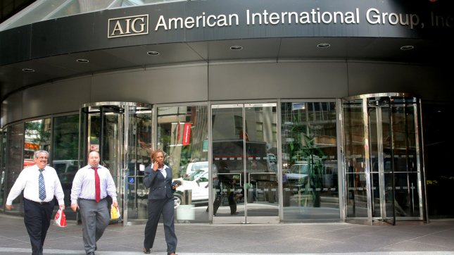 People walk past the American International Group building in the financial district after the government bailed out the insurance company on September 17, 2008 in New York City. The U.S.'s two-year, $85 billion loan was in exchange for an 80% stake in the insurance company.(UPI Photo/Monika Graff)