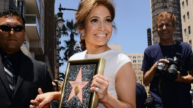 Singer and actress Jennifer Lopez holds a replica plaque during an unveiling ceremony honoring her with the 2,500th star on the Hollywood Walk of Fame in Los Angeles on June 20, 2013. UPI/Jim Ruymen