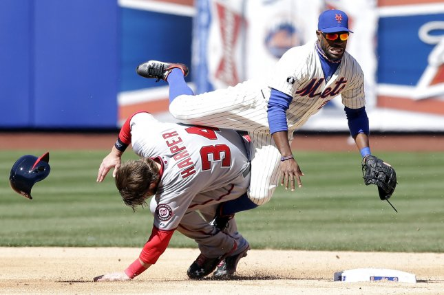 Washington Nationals Bryce Harper collides with New York Mets Eric Young Jr. sliding into second base in the second inning on Opening Day at Citi Field in New York City on March 31, 2014. UPI/John Angelillo