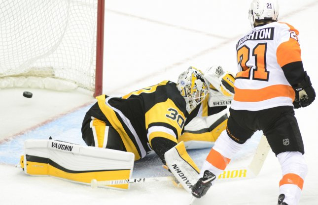 Penguins overpower Flyers 8-5 to end series