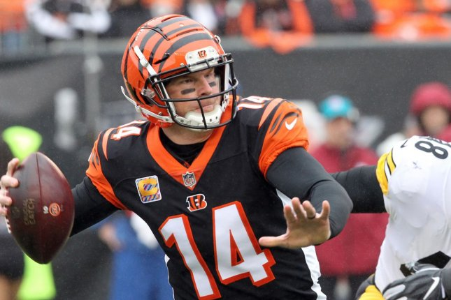Cincinnati Bengals quarterback Andy Dalton gets ready to throw under pressure during a game against the Pittsburgh Steelers at Paul Brown Stadium on October 14, 2018. Photo by John Sommers II /UPI