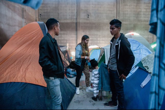 Migrants fleeing violence in their country should be allowed to apply for asylum in the United States, a court ruled Wednesday. Photo by Ariana Drehsler/UPI