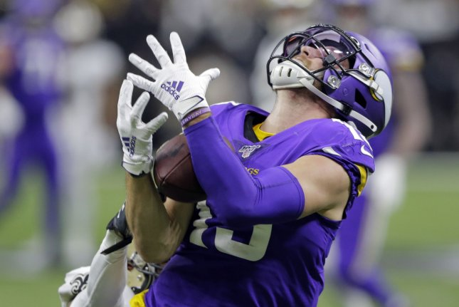 Minnesota Vikings wide receiver Adam Thielen snags a 43-yard pass during overtime against the New Orleans Saints during the NFC wild-card game Sunday in New Orleans. Photo by AJ Sisco/UPI