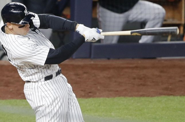 New York Yankees outfielder Aaron Judge smacks a three-run homer in the eighth inning in a win over the Baltimore Orioles Tuesday at Yankee Stadium in New York City. Photo by John Angelillo/UPI