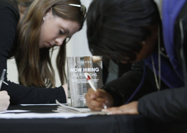 Job-seekers fill out applications at job fair for a newly opening Forever 21 store at Chicago Ridge Mall in Chicago Ridge, Illinois on November 6, 2009. The unemployment rate hit 10.2 percent in October, and represents the highest jobless rate since April of 1983. UPI/Brian Kersey