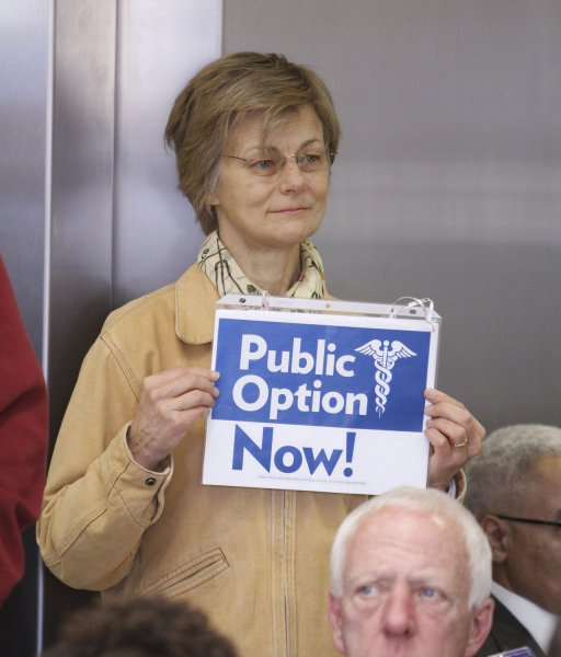 Sally Freeman holds a sign as Sen. Roland Burris (D-IL) delivers an address on health care reform at Stroger Hospital in Chicago on November 2, 2009. Burris stated his support for a strong public option. UPI/Brian Kersey