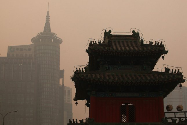 A thick smog, rated as 'Hazardous' by the U.S. embassy, hangs over central Beijing on February 20, 2014. Hazardous pollution from China travels in large quantities across the Pacific Ocean to the United States, a new study has found, making health and environmental problems an unexpected side effect of U.S. demand for cheap China-manufactured goods. Severe pollution has made the Chinese capital barely suitable for living, according to a new official Chinese report. UPI/Stephen Shaver