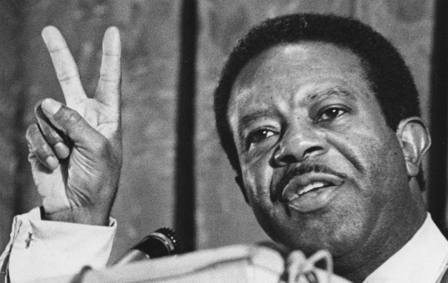 Dr. Ralph Abernathy, President of the Southern Christian Leadership Conference gives the peace sign at a panel discussion at Boston College on Dec. 8, 1969 in Boston. Abernathy's home was the site of one of six racially motivated bombings that took place on Jan. 10, 1957 in Montgomery, Alabama. Though his home was bombed, his family was unharmed. File Photo UPI