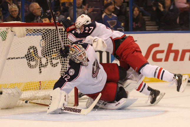 Columbus Blue Jackets Ryan Murray, seen here colliding with his goaltender in this November 2015 file photo, is expected to miss four to six weeks after suffering a broken hand in Saturday's game, the team announced Monday. File Photo by Bill Greenblatt/UPI