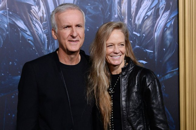 Alita: Battle Angel producer and screenwriter James Cameron (L) pictured here with his wife Suzy Amis (R). Fox has pushed back the release date for Alita along with director Shane Black's The Predator. File Photo by Jim Ruymen/UPI