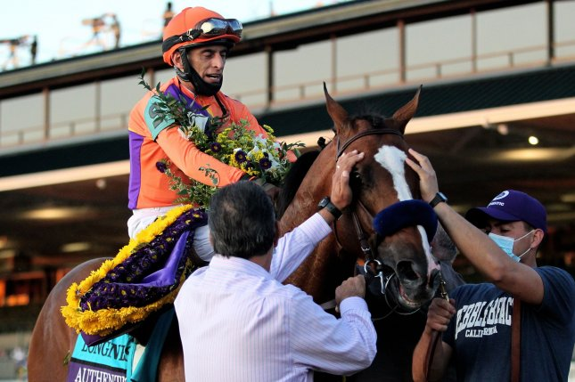 Jockey John Velazquez, riding Authentic, celebrates winning the Breeders' Cup Classic at Keeneland in Lexington, Ky., on Saturday. Photo by John Sommers II/UPI