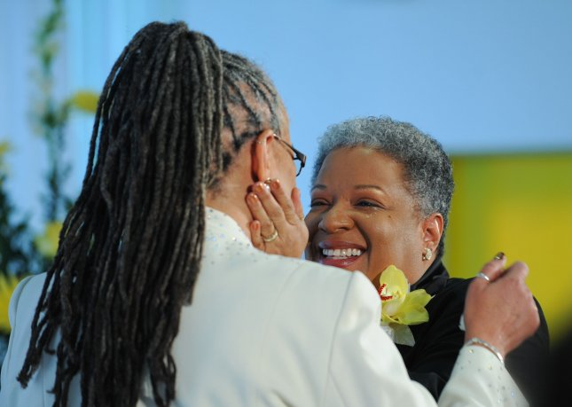 Darlene Garner (L) and Candy Holmes embrace after they exchanged marriage vows during their wedding ceremony at the Human Rights Campaign building in Washington on March 9, 2010. In December 2009, the DC Council approved a bill that would allow for same-sex marriages to be performed in the District. Today, same-sex couples were able to obtain marriage licenses they applied for last week. UPI/Alexis C. Glenn