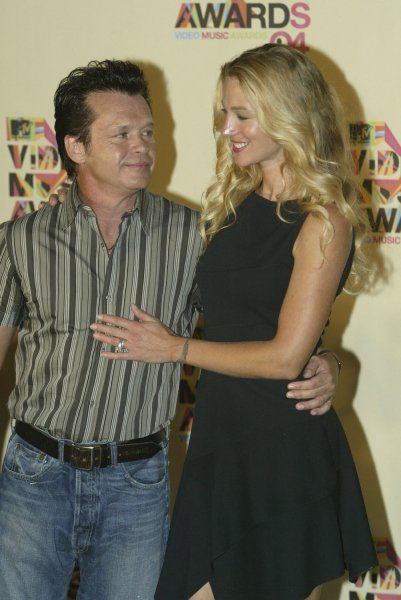 John Mellencamp and his wife pose for the media at the 2004 MTV Video Music Awards held in Miami, Florida, on August 29, 2004. (UPI Photo/Michael Bush)