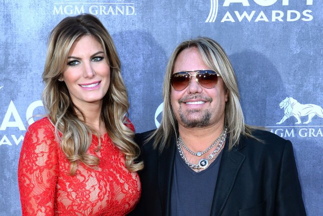 (L-R) Lia Geraldini and recording artist Vince Neil attend the 49th annual Academy of Country Music Awards in Las Vegas on April 6, 2014. File Photo by Jim Ruymen/UPI