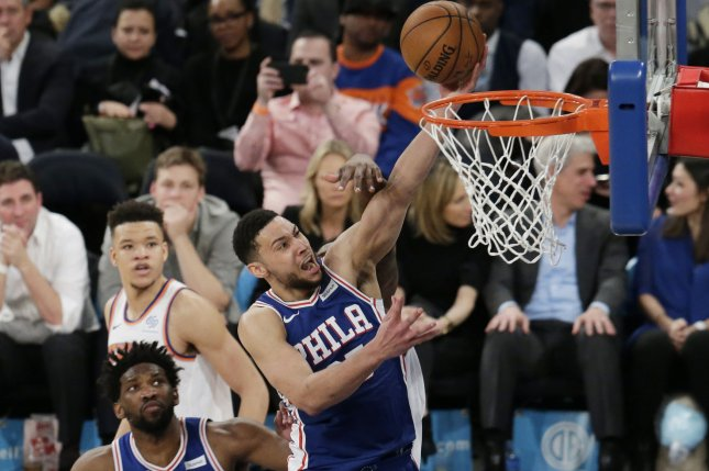 Philadelphia 76ers guard Ben Simmons (C) appeared to elbow Toronto Raptors guard Kyle Lowry in the groin during Game 3 Thursday night. No foul was called on the play. File Photo by John Angelillo/UPI