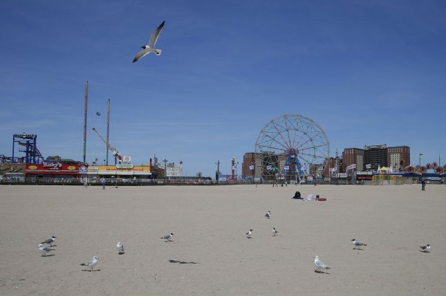 The beaches at Coney Island are empty Sunday as no date has been set to reopen after weeks of closure due to the coronavirus pandemic, on Coney Island in New York City. Photo by John Angelillo/UPI
