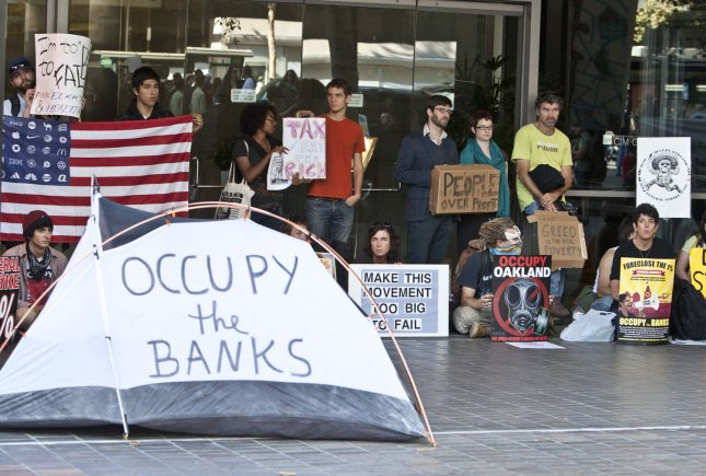 A group of protesters blocks the enterance to a Citi Bank branch in Oakland, California on November 3, 2011. Occupy Oakland has called for a general strike today. UPI/Terry Schmitt