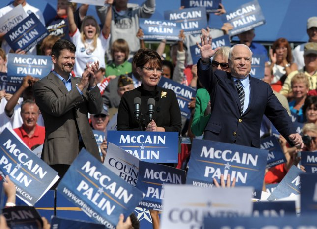 Republican Presidential Nominee Sen. John McCain (AZ) (R), and Vice Presidential Nominee Alaska Gov. Sarah Palin appear together at a campaign rally in Fairfax, Virginia, on September 10, 2008. At left is Palin's husband Todd. (UPI Photo/Roger L. Wollenberg)