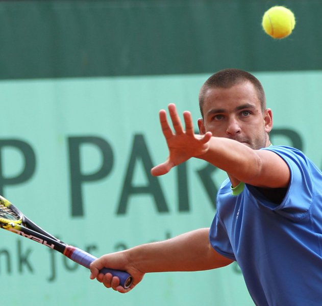 Mikhail Youzhny, in a file photo from the 2011 French Open, has advanced to the quarterfinals of the St. Petersburg Open with a victory Wednesday. UPI/David Silpa