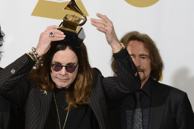 (L-R) Ozzy Osbourne and Geezer Butler of Black Sabbath hold their Grammy Award for Best Metal Performance for the song 'God is Dead?' at the 56th annual Grammy Awards at Staples Center in Los Angeles on January 26, 2014. (File/UPI/Phil McCarten)