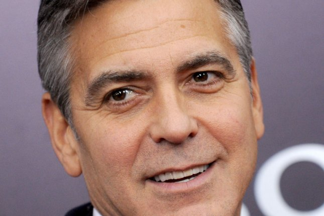 George Clooney arrives on the red carpet at 'The Monuments Men' premiere at the Ziegfeld Theatre in New York City on February 4, 2014. UPI/Dennis Van Tine